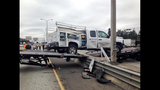 PHOTOS: Truck lands on guardrail, crosses freeway - (2/7)