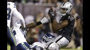 Oakland Raiders wide receiver Brice Butler (12) catches a 15-yard touchdown pass from quarterback Matt McGloin during the second quarter of an NFL preseason football game against the Seattle Seahawks in Oakland, Calif., Thursday, Aug. 28, 2014. (AP Photo/Ben Margot)