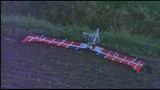 Ultralight plane crashes into power lines; Pilot up, walking_6279103