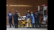 Firefighters, medics and hospital staff move one of the Marysville Pilchuck High School shooting victims from an ambulance into Providence Regional Medical Center in Everett, Friday, Oct. 24, 2014, following the shooting at the high school. A student walked into his Seattle-area high school cafeteria on Friday and opened fire without shouting or arguing, killing one person and shooting several others in the head before turning the gun on himself, officials and witnesses said. (AP Photo/The Herald, Dan Bates)