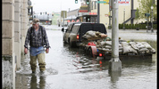 Gordon West walks from his truck towing a trailer of sandbags Monday, Jan. 5, 2015 next to the flooded office building he owns in Aberdeen, Wash. Read updates about flooding in Western Washington here >> http://kiro.tv/StormFlooding (AP Photo/Ted S. Warren)