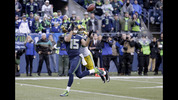 Seattle Seahawks' Jermaine Kearse catches the game-winning touchdown pass in front of Green Bay Packers' Tramon Williams during overtime of the NFL football NFC Championship game Sunday, Jan. 18, 2015, in Seattle. The Seahawks won 28-22 to advance to Super Bowl XLIX. (AP Photo/David J. Phillip)