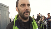 Singer Dave Matthews talks to reporters before raising the 12th Man flag on the Space Needle in January 2015.