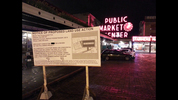 """On a sign at Pike Place Market, he wrote that there would be a """"mixed use condo/retail structure including the first of its kind subterranean Whole Foods/Trader Joe's connected with the new SR-99 tunnel named Cash Hole Foods. With a little room left over for a Pike Place Farmers Market Museum!"""""""