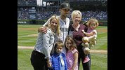 Seattle Sounders MLS soccer forward Clint Dempsey, upper center, poses for a photo with family members after he threw out the first pitch of a baseball game between the Seattle Mariners and the Boston Red Sox Sunday, May 17, 2015, in Seattle. (AP Photo/Ted S. Warren)