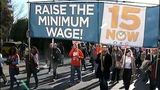 Seattle workers demand a minimum wage increase._7397898