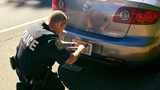 Officer Jim Allen helps woman pulled over_7811440