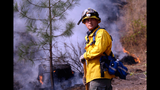 On long shifts, firefighters brave Wash.'s largest wildfire _8003596