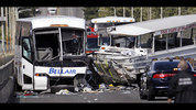 A charter bus, left, and an amphibious tour vehicle remain on the Aurora Bridge after colliding in a deadly crash involving several vehicles Thursday, Sept. 24, 2015, in Seattle. (AP Photo/Elaine Thompson) Click here for updates.