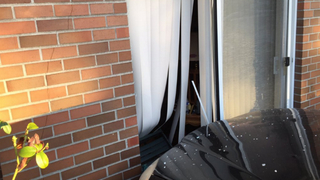 Car crashes into Federal Way building, injures 1