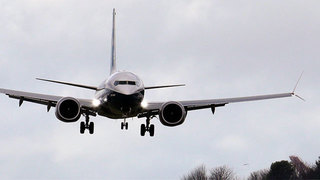 Boeing to cut execs and managers