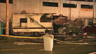 Two burned in RV fire at designated lot for homeless