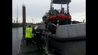 Coast Guard rescues buoy-clinging boaters