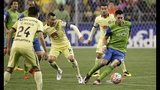 Seattle Sounders forward Clint Dempsey, right, clears the ball away from Club America midfielder Rubens Sambueza during the first half of a CONCACAF Champions League soccer quarterfinal, Tuesday, Feb. 23, 2016, in Seattle. (AP Photo/Ted S. Warren)