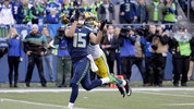 FILE: Seattle Seahawks' Jermaine Kearse catches the game-winning touchdown pass in front of Green Bay Packers' Tramon Williams during overtime of the NFL football NFC Championship game Sunday, Jan. 18, 2015. (AP Photo/David J. Phillip)