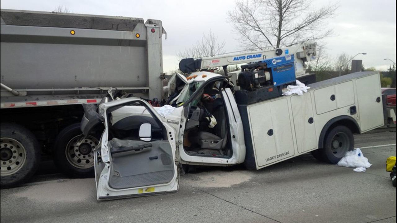 Truck wedged under dump truck in 405 crash | KIRO-TV