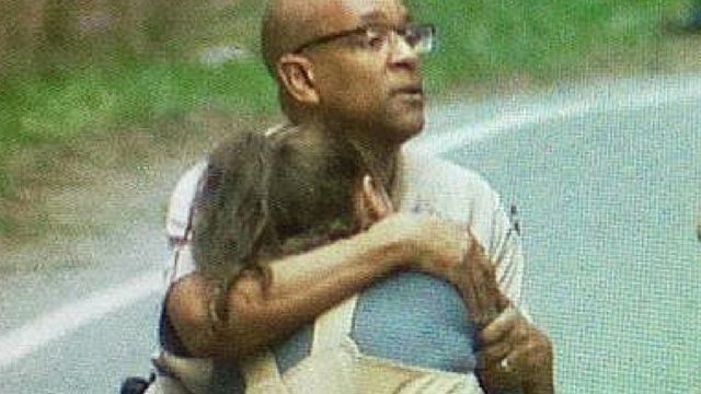 Snohomish County sheriff's Lt. Rodney Rochon held the mother of one of the women killed after he gave her the terrible news at the scene of the crash.