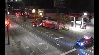 Car hits building, ruptures gas line in Greenwood neighborhood