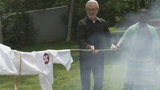 """A Ku Klux Klan-style robe was left at this consignment owner's shop. She is burning it to """"reclaim her life."""""""