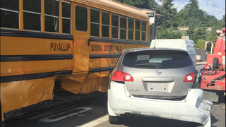 Fleeing armed robber hits Puyallup school bus