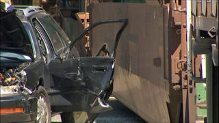 Car struck by slow-moving train in South Seattle