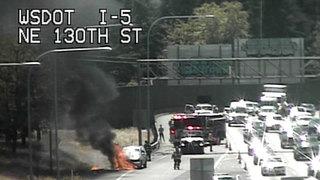 Car fire slows traffic on NB I-5 near Northgate