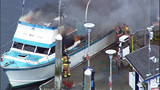 RAW VIDEO: Boat burns at Des Moines Marina