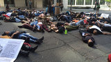 Protesters lie down in front of Seattle police headquarters last week.