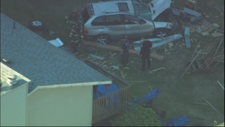 Vehicle crashes through home in Renton