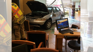 Car attempting to park crashes into vision clinic lobby