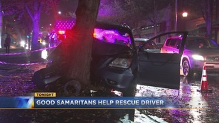 Greenwood neighbors rush to rescue man trapped after crash