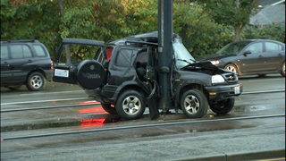 Crash closes light rail tracks, busy road for hours