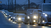 Vehicles make a line as they flee following a tsunami warning in Iwaki, Fukushima prefecture early Tuesday, Nov. 22, 2016.  (Kyodo News via AP)