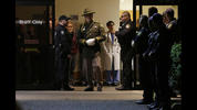 Hospital and law enforcement workers stand at an entrance to Tacoma General Hospital in Tacoma, Wash., as they wait for the body of a Tacoma Police officer who was shot and killed while answering a domestic violence call Wednesday, Nov. 30, 2016, to be removed from the hospital in a procession. Tacoma Police spokeswoman Loretta Cool said the officer was pronounced dead at the hospital Wednesday evening.
