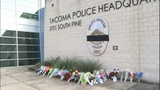 PHOTOS: Mourners leave flowers for fallen… - (9/18)