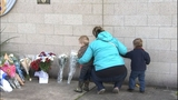 PHOTOS: Mourners leave flowers for fallen… - (1/18)