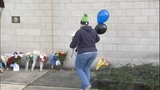 PHOTOS: Mourners leave flowers for fallen… - (2/18)