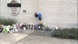 PHOTOS: Mourners leave flowers for fallen… - (5/18)