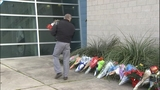PHOTOS: Mourners leave flowers for fallen… - (12/18)