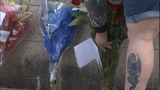 PHOTOS: Mourners leave flowers for fallen… - (11/18)