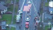A procession for Officer Jake Gutierrez took his body from the Pierce County Medical Examiner's office to a funeral home in Tacoma on Friday, Dec. 2, 2016.