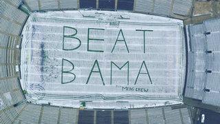 Crew writes message in snow at Husky Stadium: