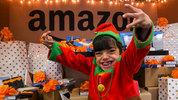Amazon elf, Gio Caro spreads holiday cheer to his fellow patients and families at Seattle Children's Hospital. Photographer: Ben VanHouten