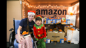 Gio Caro smiles alongside a fellow patient during a surprise event at Seattle Children's Hospital hosted by Amazon. Photographer: Ben VanHouten