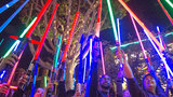 """File: Fans of actress Carrie Fisher honored her death by pointing their lit """"Star Wars"""" light sabers to the sky at 7 p.m. at Downtown Disney, Wednesday night, Dec. 28, 2016, in Anaheim. (Mark Eades/The Orange County Register via AP)"""