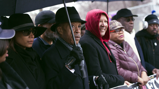 Marchers brave cold and rain for MLK march, rally against Trump