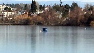 Green Lake freezes over, dumpster rolled onto lake