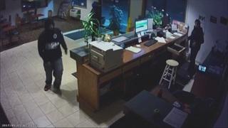 Motel clerk describes being held at gunpoint