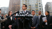 Washington Attorney General Bob Ferguson, center, talks to reporters Friday, Feb. 3, 2017, following a hearing in federal court in Seattle. (AP Photo/Ted S. Warren)