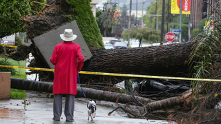 2 dead, torrents of rain slam Southern California, opening sinkholes